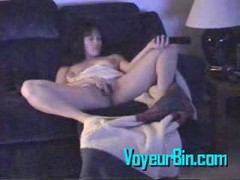 Clit, Milf, Brunette milf fingers her clit while watching porn