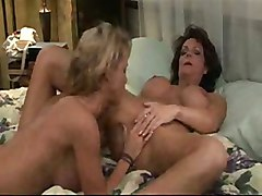 Two woman seduces young girl