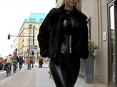 Latex, Blonde puts on latex catsuit