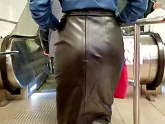 Leather, Sexy girl com a in skirt pulls her panties asi