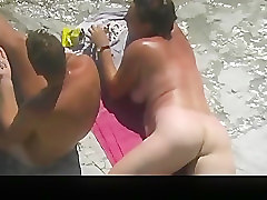 Nudist, Beach, Woman watches man jack off